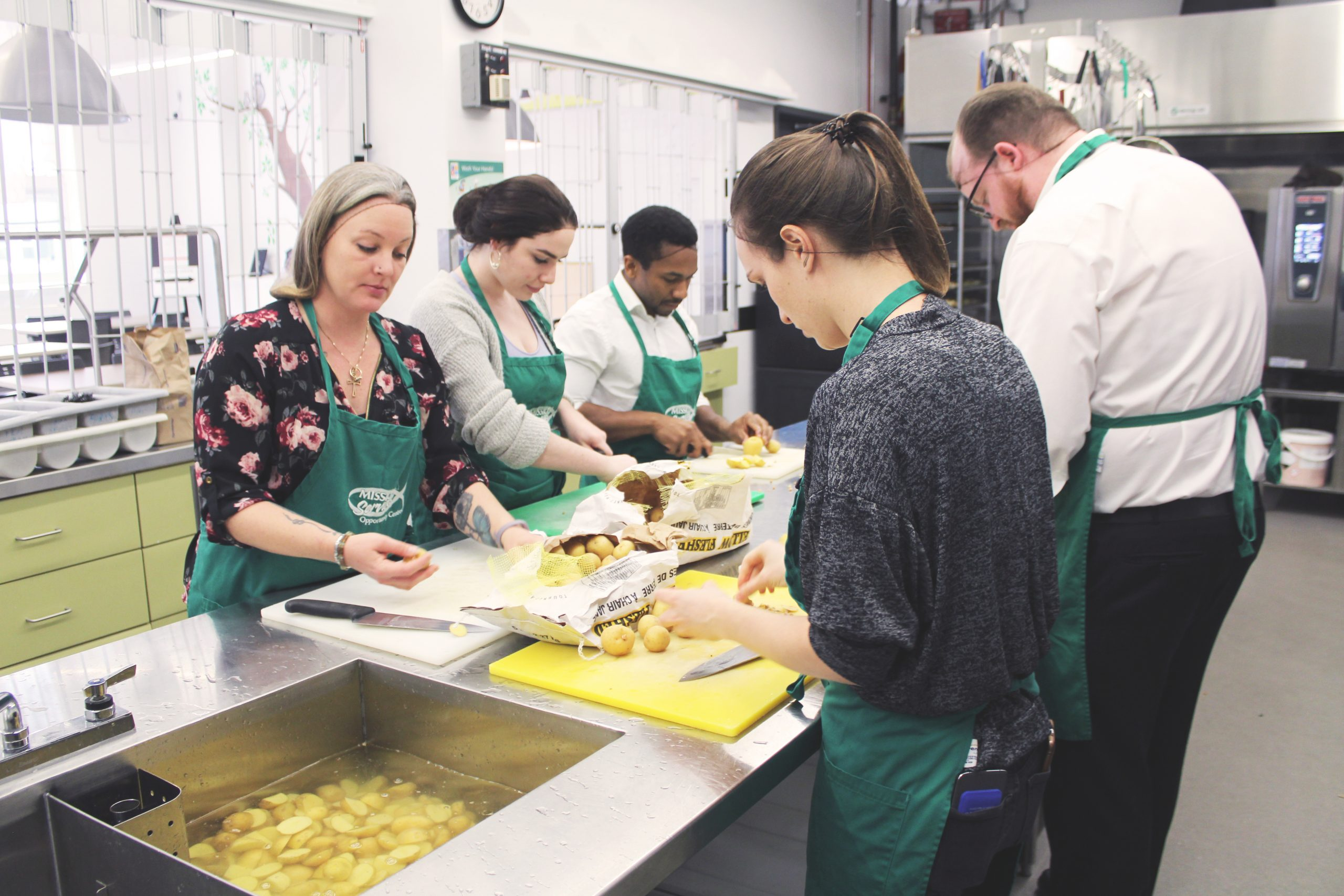 Volunteers helping prep food
