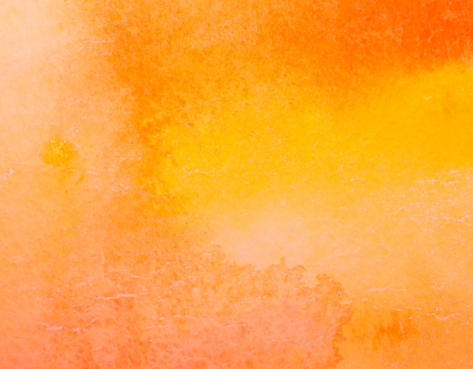 An image of different varieties of orange watercolour paint covering the entire image